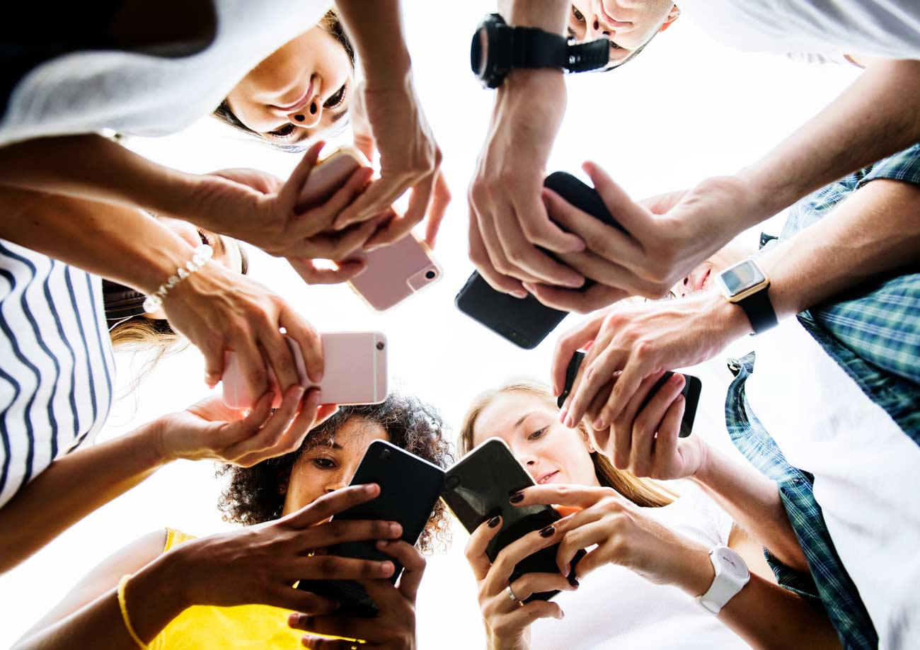 young-adults-using-smartphones-in-a-circle-social